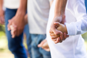 family holding hands close up